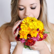 Woman smelling a bouquet — Stock Photo #14854015
