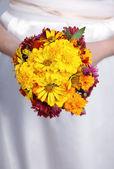 Hands holding an bouquet — Stock Photo