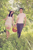 Young couple with a basket — Stock Photo