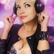 Foto Stock: Blonde listens to music