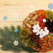 Fir-tree and dried fruit — Stock Photo
