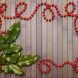 Garland and holly leaves - Stock Photo