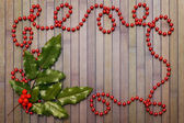Garland and holly leaves — Stock Photo