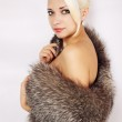 Woman in a fur cape — Stock Photo #17504131