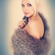 Woman in a fur cape — Stock Photo #17504311