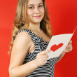 Stock Photo: Reading greeting card
