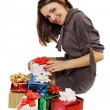 Stock Photo: Womsits near gifts