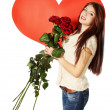 Woman with a bouquet of roses — Stock Photo