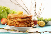 Pancakes and willow branches — Stock Photo