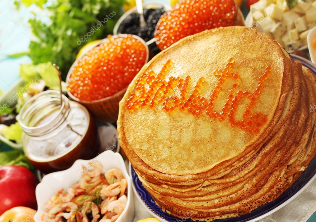 Large stack of pancakes with different fillings — Stock Photo #19835973
