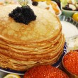 Постер, плакат: Caviar on pancakes