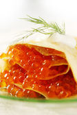 Eggs in pancakes — Stock Photo