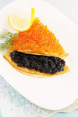 Flapjack with caviar and lemon — Stock Photo