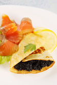 Flapjack, caviar and salmon — Stock Photo