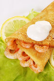 Pancake with sour cream — Stock Photo