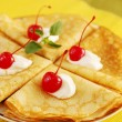 Pancakes and cherries — Stock Photo