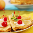 Pancakes with cherries — Stock Photo