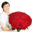 Woman holds a huge bouquet — Stock Photo