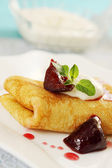 Pancake with plum — Stock Photo