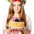 Royalty-Free Stock Photo: Ukrainian holds pancakes