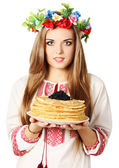 Ukrainian holds pancakes — Stock Photo
