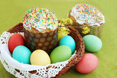 Colored eggs and cake — Stock Photo