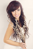 Brunette with blooming willow — Stockfoto