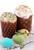 Easter cakes and cherry branch — Stock Photo