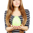 Stock Photo: Woman holds a green egg