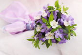Bouquet of violets and apricot — Stock Photo