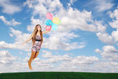 Woman on the balloons — Stock Photo
