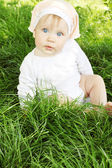 Girl is sitting on grass — Stock Photo