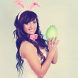 Stock Photo: Beautiful rabbit holding egg,tinted