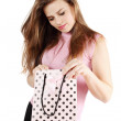 Woman looks in bag — Stock Photo