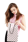 Woman looks in bag — Stock Photo