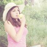 Girl eating an apple — Stock Photo #26568573
