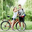 Cyclist shows the way the traveler — Stock Photo #26568109