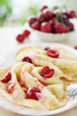 Pancakes with cherry and pine nuts — Stock Photo