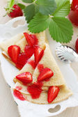 Fried pancakes with strawberries — Stock Photo