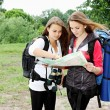 Stock Photo: Young girls with backpacks