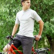 Bicyclist in a summer park — Stock Photo