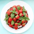 Foto Stock: Cake with strawberry, top view