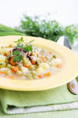 Soup with fresh green peas — Stock Photo