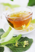 Cup of lime tea — Stock Photo