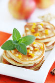 Pancakes with pine nuts — Stock Photo