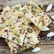 Pastry with pumpkin seeds — Stock Photo #27096827