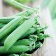 Peas in bowl — Stock Photo #27097053