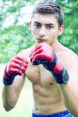 Kickboxer in red gloves — Stock Photo