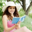 Woman with a book in hand — Stock Photo