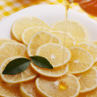 Stock Photo: Pour honey lemon slices